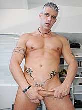 Grey Haired Stud Eric Poses